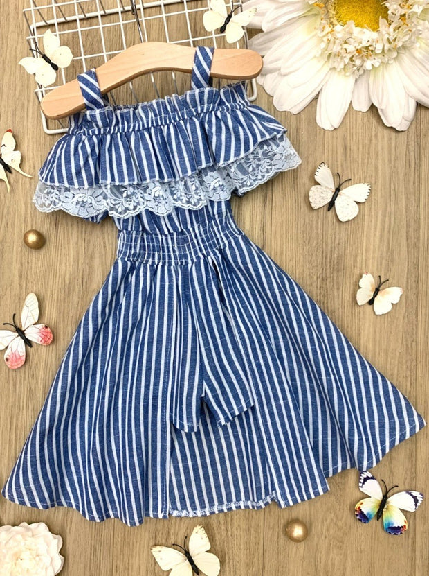 girls Spring romper has an off-the-shoulder neckline with straps, a ruffled bib with lace, the romper shorts have an open skirt overlay to add a little spice