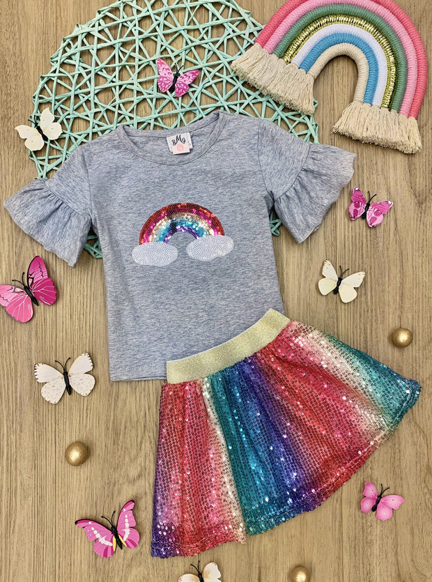 Girls set features a grey top with short ruffled sleeves with sequin rainbow and clouds detail and a rainbow sequin skirt