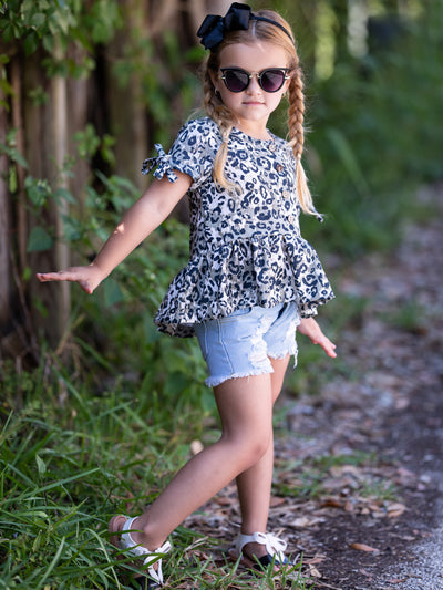 girls set features a leopard printed top with distressed denim shorts