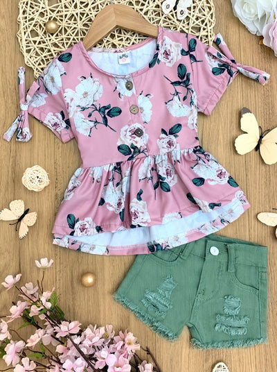 Girls set features a pink floral top with bow details on short sleeves and distressed denim shorts