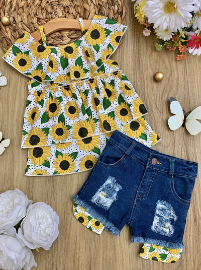 girls set features a white top multi-layer top with off-shoulder sleeves and sunflower print and denim shorts with sunflower patches