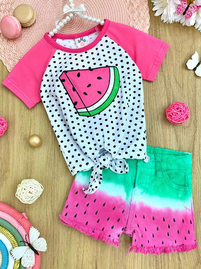 Girls set features a raglan t-shirt with polka dot base and watermelon print and knot at the waist with tie-dye denim shorts