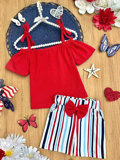 Girls  set features a red off-shoulder top with adjustable straps and striped belted shorts