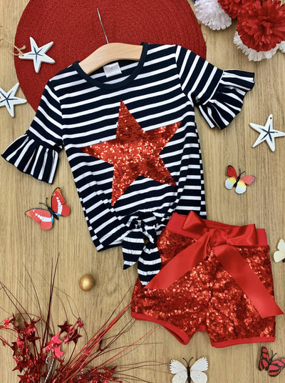 Girls set features a Navy/White striped top with red sequin star and sequin shorts with sash