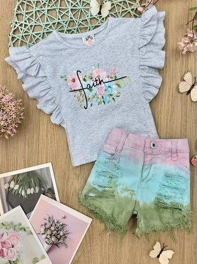 "Girls set features a grey ruffled top with floral ""Faith"" graphics and tie-dye denim short"