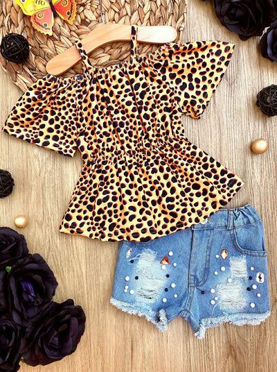Girls set features an off-shoulder leopard top with denim shorts with little pearl details