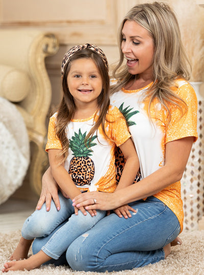 mommy and me top features an orange tie-dye print with a pineapple 2T-10Y