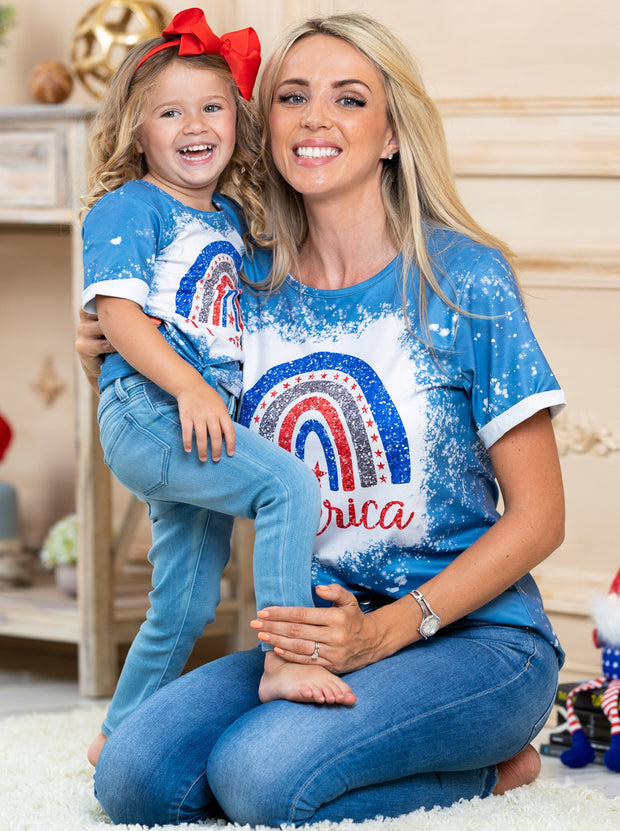 "mommy and me blue light tie-dye top features an ""America"" graphic print"