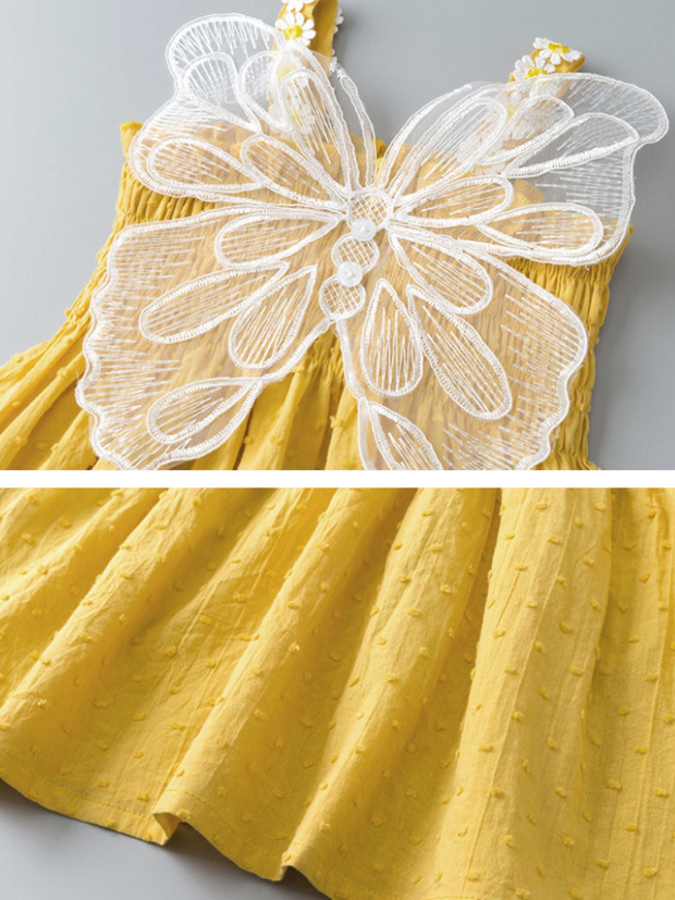 The dress has a stretchy bodice and daisy straps and little fairy wings on the back yellow