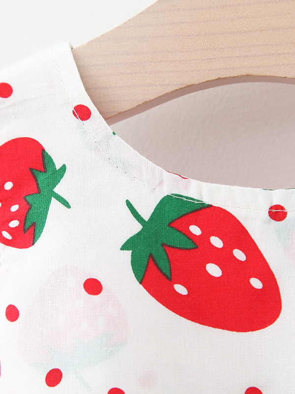 dress has an adorable strawberry print and a large bow at the back and comes with a matching hat