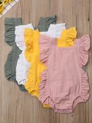 Baby onesie has cute little shoulder ruffles and ruffles on the side. Overall style with strap closure at the back White pink yellow green