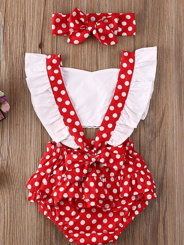 Baby overall style onesie with ruffles on the bum that ties in the back and a matching headband Red