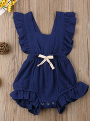 Baby bohemian Overall style romper onesie that ties in the back and has a drawstring at the waist. Little ruffled adorn the shoulder and short hem navy