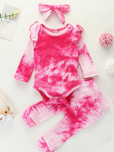 Baby set features a tie-dye long-sleeved onesie with ruffled shoulders, ruffled leggings, and matching headbands