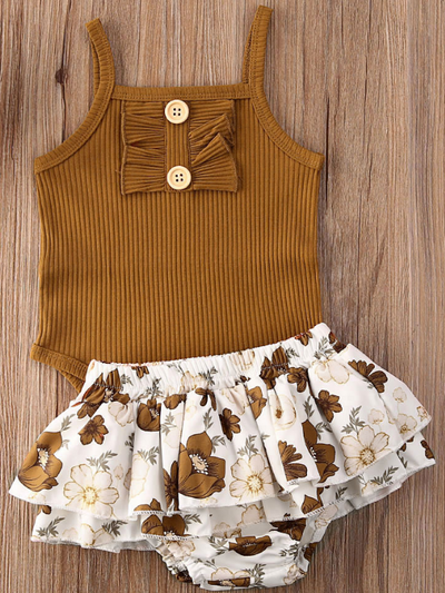 Baby onesie bodysuit has a cute ruffle detail and front buttons and spaghetti straps and skirted bloomers