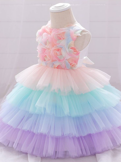Baby Spring tulle dress' bodice has a delicate flower applique in tulle, has a multicolor layered skirt and bow at the back
