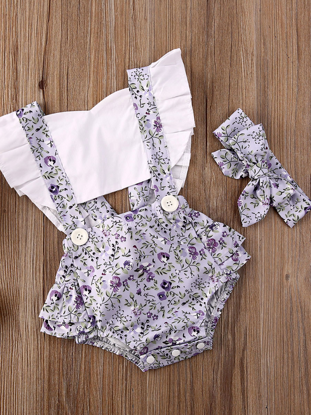 Baby overall style onesie with ruffles on the bum that ties in the back and a matching headband lilac
