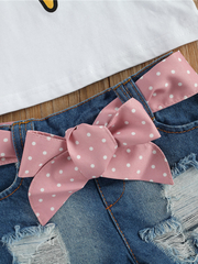 Girls set features a top with an ice cream with pom-poms and distressed denim shorts with a pink polka dot sash