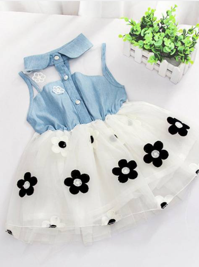 Baby tutu dress has a denim and mesh bodice with front button closure and a tutu skirt with flower applique