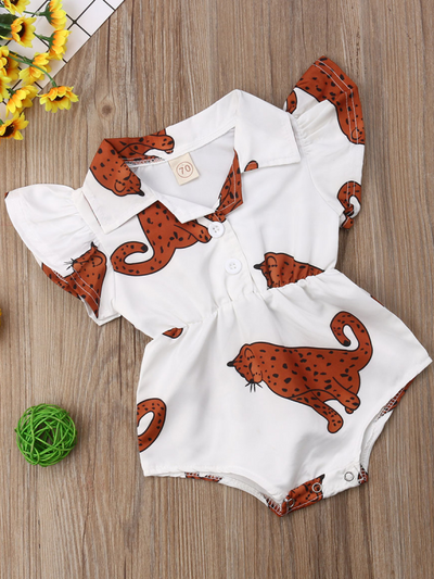 Baby white onesie with leopards printed has ruffled short sleeves and a cute collar. Front button and elastic waist.