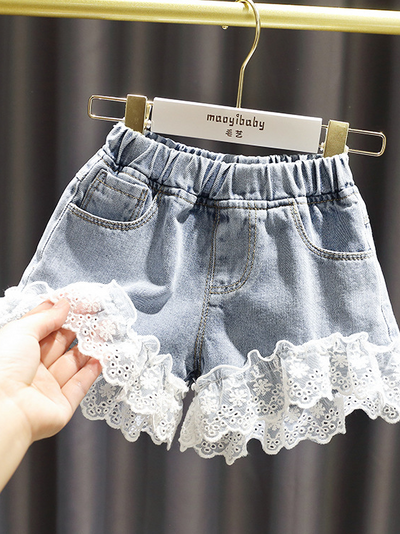Girls shorts have an elastic waistband, front pockets, and a cute lace hem