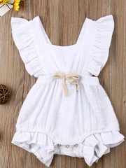Baby bohemian Overall style romper onesie that ties in the back and has a drawstring at the waist. Little ruffled adorn the shoulder and short hem white