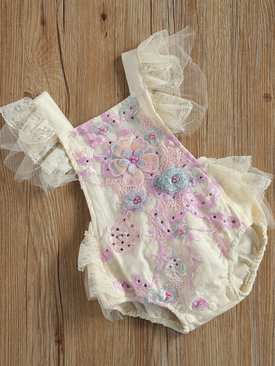 Baby overall style onesie with delicate flower embroidered, lace ruffles on the bum that ties in the back, tulle, and lace ruffled shoulders