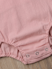 Baby onesie has cute little shoulder ruffles and ruffles on the side. Overall style with strap closure at the back