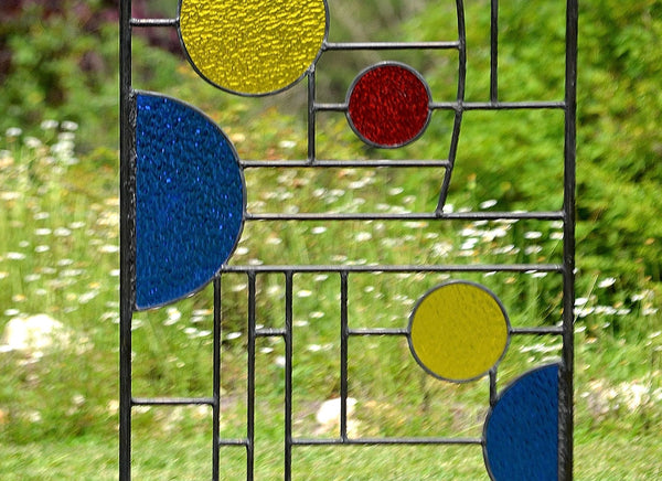 metal and stained glass yard art