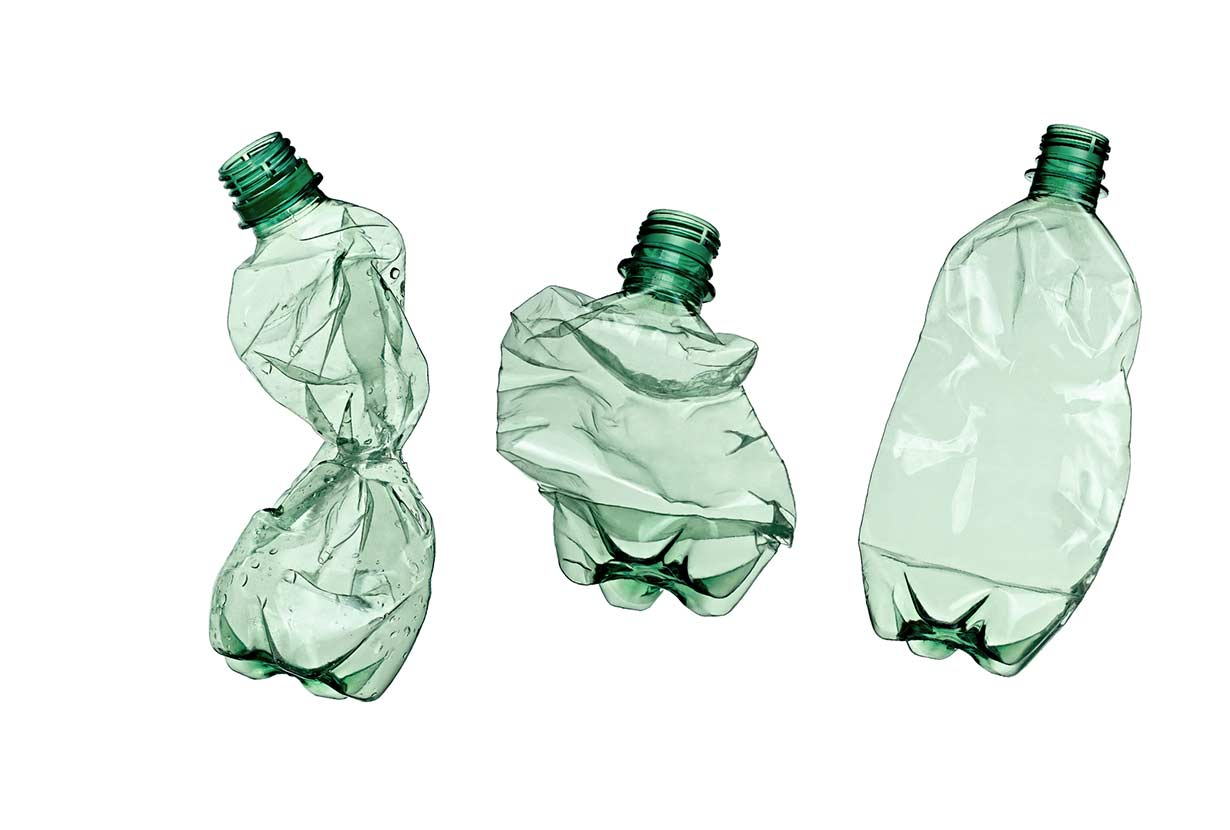 Three crushed plastic water bottles