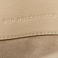 The Handheld in Technik-Leather in Oat & Caramel