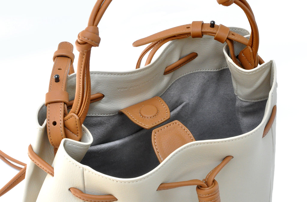The Mini Bucket Crossbody in Technik-Leather in Oat & Caramel