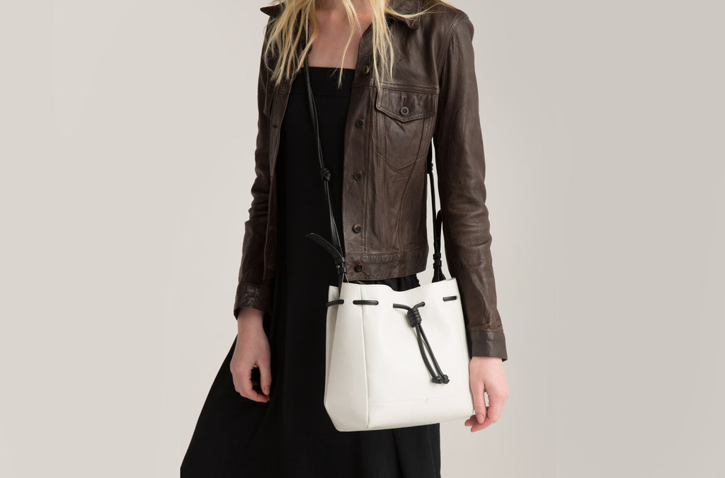 The Mini Bucket Crossbody in Technik-Leather in White and Black