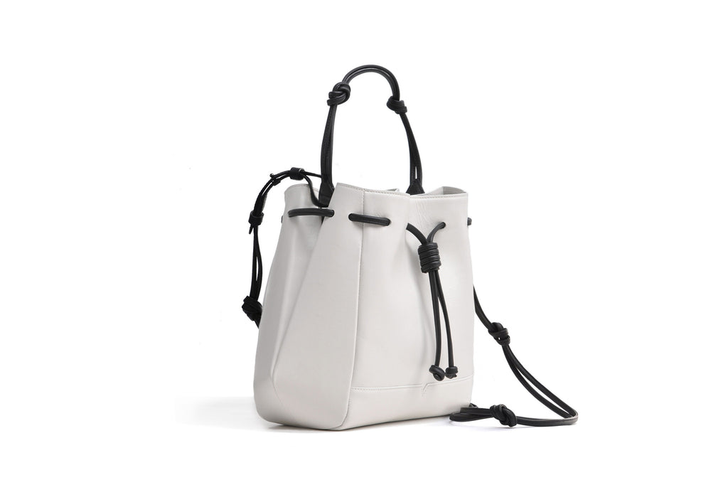 The Bucket Crossbody in Technik-Leather in White and Black