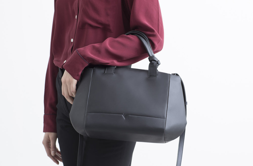 The Mini Duffel Crossbody in Technik-Leather in Black