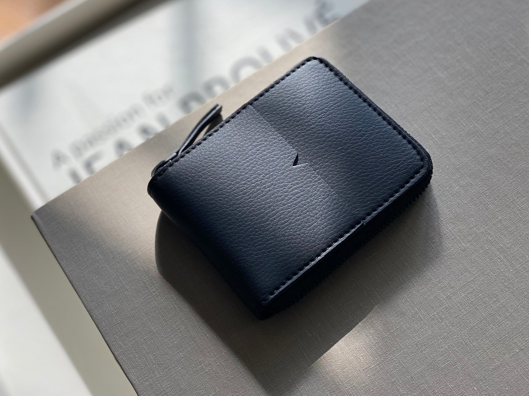 The Zip-Around Wallet in Technik-Leather in Black