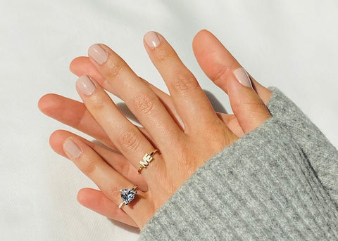 Woman wearing The Self Love Pinky Ring and The ME Ring