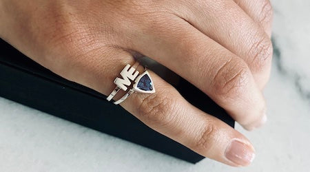 Woman wearing The Self Love Pinky Ring Birthstone Collection and The ME Ring