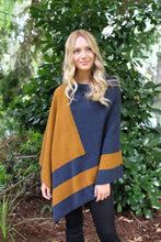 Load image into Gallery viewer, Asymmetrical possum merino poncho with geometric pattern in contrast colour. Textured knit structure feature in contrast panel. Lothlorian. Made in New Zealand. Gold