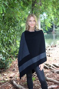 Asymmetrical possum merino poncho with geometric pattern in contrast colour. Textured knit structure feature in contrast panel. Lothlorian. Made in New Zealand. Charcoal