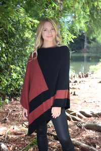 Asymmetrical possum merino poncho with geometric pattern in contrast colour. Textured knit structure feature in contrast panel. Lothlorian. Made in New Zealand. Dusk
