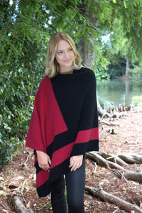 Asymmetrical possum merino poncho with geometric pattern in contrast colour. Textured knit structure feature in contrast panel. Lothlorian. Made in New Zealand. Raspberry