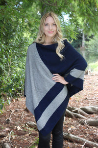 Asymmetrical possum merino poncho with geometric pattern in contrast colour. Textured knit structure feature in contrast panel. Lothlorian. Made in New Zealand. Silver