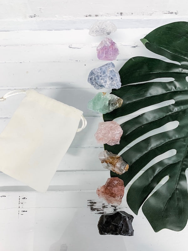 A set of rough cut crystals to balance the chakras, by The Purist Collection