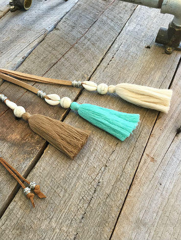tassel leather necklace with shell and stone centrepiece