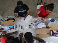 University of Miami Students assemble care packages for soldiers during Homecoming week