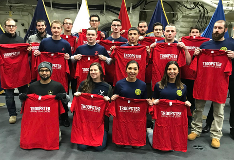 New US Navy enlistees hold Troopster t-shirts aboard littoral combat ship USS Little Rock
