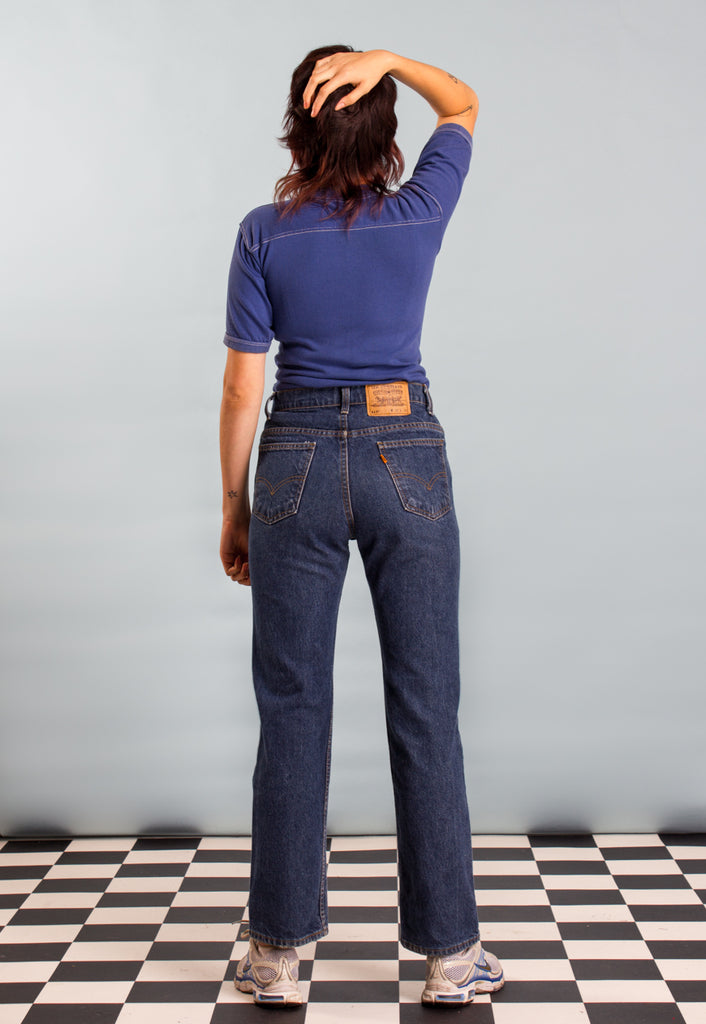 Vintage Levi 571 Boot-cut Jeans in Dark Denim