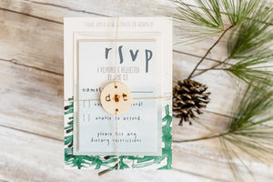 watercolor tree wedding invitation with woodburned belly band