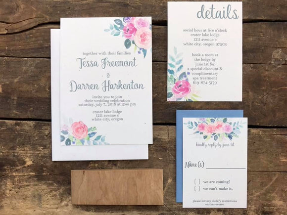 Watercolor pink floral wedding invitation with dusty blue envelopes and wood paper belly band
